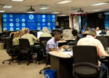 Group of government officials monitoring Programmatic Readiness Capabilities and Real-time Performance in support of the National Essential Functions (NEFs)